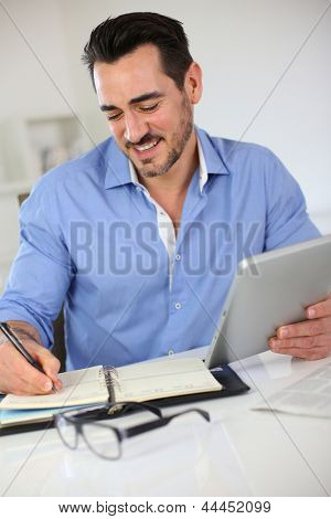 Smiling businessman working from home