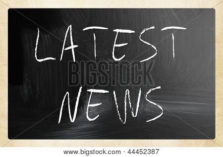 """latest News"" Handwritten With White Chalk On A Blackboard"