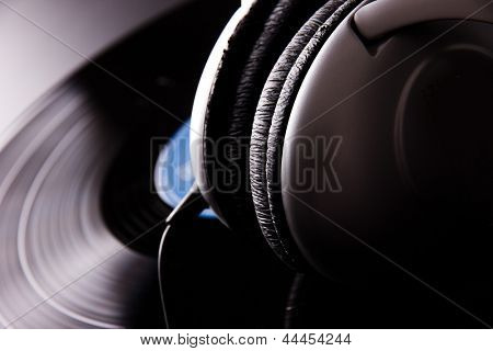 Vinyl disc with headphones close-up
