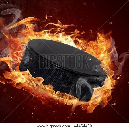 Hot hockey puck in fires flame