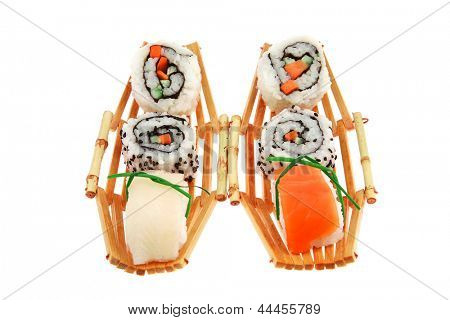 Japanese traditional Cuisine - Roll with Cucumber , Cream Cheese and Raw Salmon inside. Sashimi topped Smoked Salmon and raw Eel . Isolated over white background