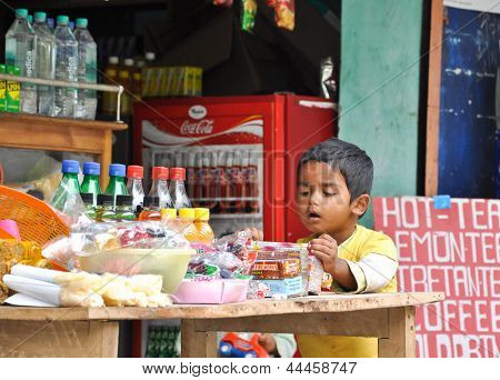 Indian Boy Selects Snack In The Grocery