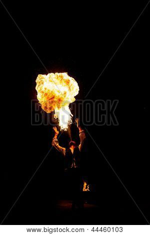 Street Performer Fire Breather Blowing on Torch