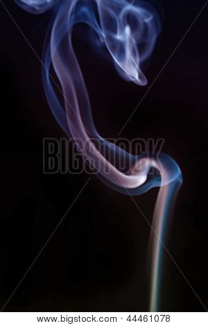 Swirling Smoke From The Incense On A Homogeneous Background