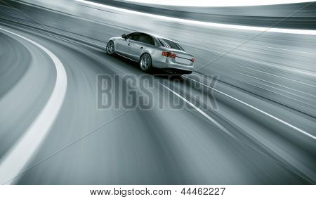 3d rendering of a brandless generic car of my own design in a tunnel with heavy motion blur