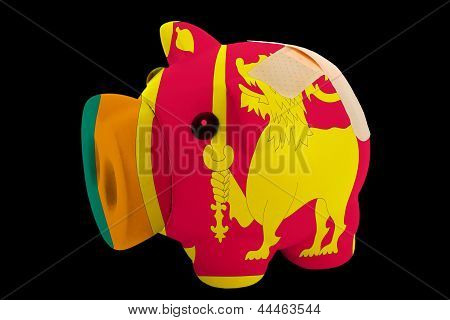 Bankrupt Piggy Rich Bank In Colors Of National Flag Of Srilanka    Closed With Bandage