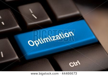 Blue Key With Optimization Word On Laptop Keyboard.