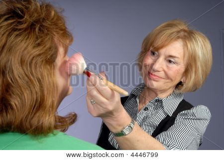 Attractive Mature Lady Make Up Artist Applies Blusher
