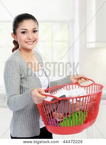 Woman With A Basket Of Loundry