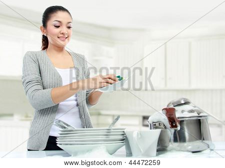 Asian Woman Doing House Work