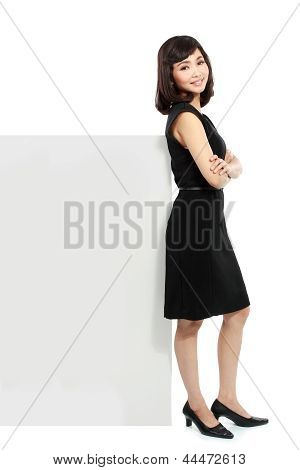 Business Woman With A Blank Billboard