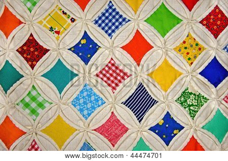 colorful Cathedral Window quilt
