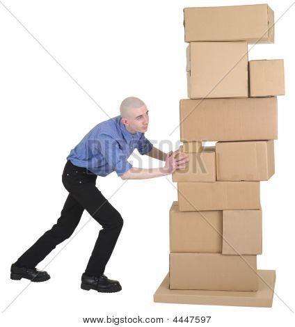 Man Pushing Pile Cardboard Boxes