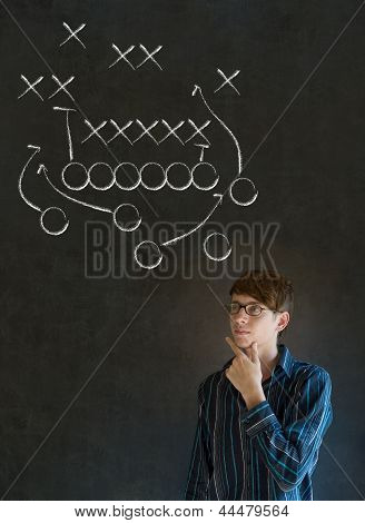 Man With American Football Strategy On Blackboard