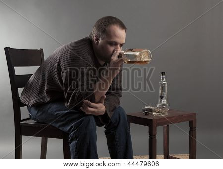 depressed man gets drunk