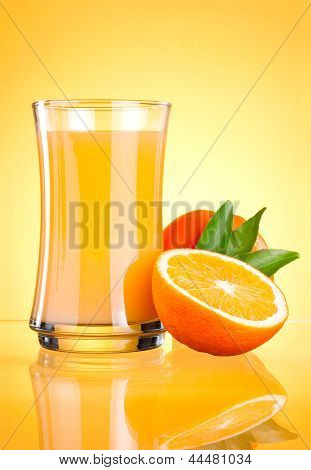 Glass Of Fresh Orange Juice On Yellow Background
