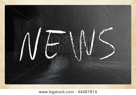 "The Word ""news"" Handwritten With White Chalk On A Blackboard"