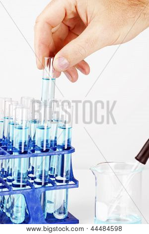 Man Picking Up Sample In Test Tube