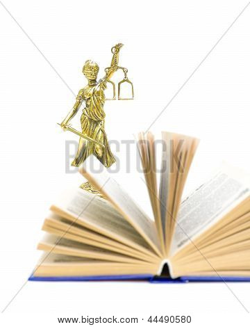 Statue Of Justice And The Book. Vertical Photo.