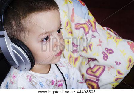 Little Boy Watching Cartoons Before Bedtime