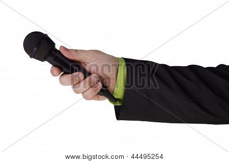Man's hand holding a microphone