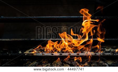 Fire Burning On Grill
