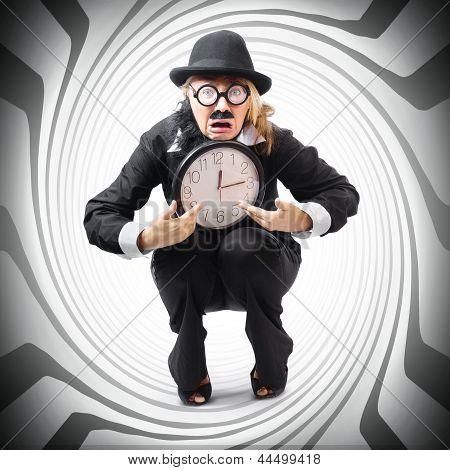 Hombre de negocios Vintage pegado con reloj. Contracción del tiempo