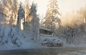 image of nea  - Hut nea water and misty forest in winter in Lapland Finland - JPG