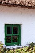 Green rimmed window on thatched house in Ireland
