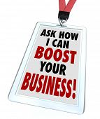 picture of revenue  - The words Ask Me How I Can Boost Your Business on a badge to advertise a service to improve your company - JPG