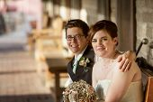 image of gay wedding  - Cheerful Caucasian gay female couple sitting together - JPG