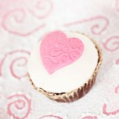 foto of sugar paste  - A cupcake with sugar paste pink heart - JPG