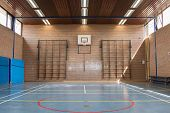 stock photo of bleachers  - Interior of a gym at school jumping high at the basket - JPG