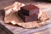 foto of chocolate fudge  - Tasty and fresh chocolate brownies on the paper - JPG