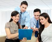 picture of employee month  - Portrait of successful business team discussing a monthly report - JPG