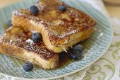 picture of french toast  - French toast with powdered sugar and maple syrup.