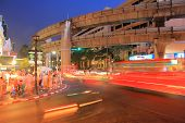 stock photo of hustle  - The hustle and bustle of downtown Bangkok tourists and cars on the road - JPG