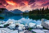 Mountain lake in National Park High Tatra. Dramatic overcrast sky. Strbske pleso, Slovakia, Europe.