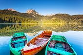 pic of boat  - Reflection in water of mountain lakes and boats - JPG
