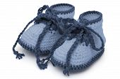picture of booty  - Blue crochet baby booties isolated on white Hand - JPG