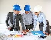 foto of presenter  - Team of architects presenting construction project - JPG
