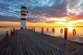 stock photo of lighthouse  - Lighthouse at Lake Neusiedl at dramatic sunset - JPG