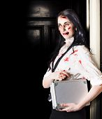 stock photo of walking dead  - Dead female zombie worker holding briefcase while walking in office space - JPG