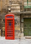 picture of phone-booth  - Old style red phone booth on a street in Valletta in the European country of Malta along the Mediterranean - JPG