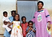 stock photo of shy girl  - Family with pregnant African woman with five daughters - JPG