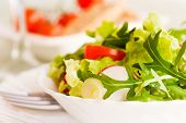 stock photo of low-light  - Healthy vegetable salad with lettuce spring onion rocket salad tomatoes and radish - JPG