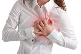 stock photo of breast-stroke  - Woman having a pain in the heart area isolated in white red circle around painful area - JPG