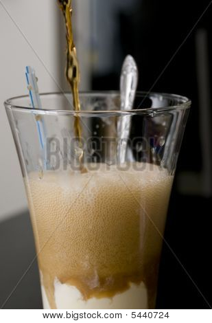 Pouring A Root Beer Float