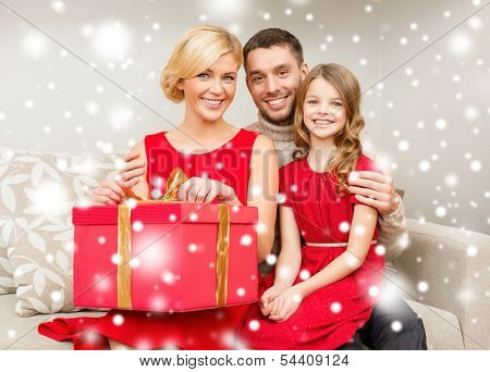 family, christmas, x-mas, winter, happiness and people concept - happy family opening