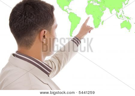 Young Business Man Showing Something On The World Map